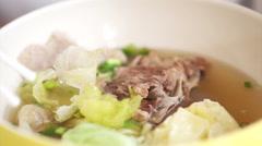 Eating Chinese food, wonton dumpling soup Stock Footage