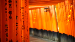 Red gate torii at Fushimi Inari temple shrine in Kyoto, Japan Stock Footage