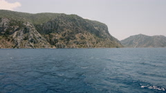 Aegean Sea with deep blue water, coast island view from the sea Stock Footage