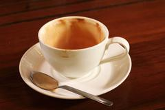 Empty used coffee cup Stock Photos