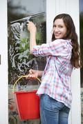 Portrait Of Woman Cleaning House Windows Stock Photos