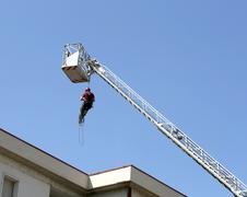 Firefighter down with the rope in the building Stock Photos