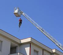 Expert firefighter down with the rope in the building during a fire alarm Kuvituskuvat