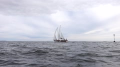 Sailboat on a gray and cloudy day Stock Footage