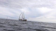 Sailboat on a rough sea - stock footage