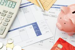 Variety Of Financial Objects Arranged On Wage Slip Stock Photos