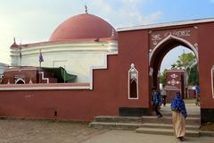 Pilgrims at Ulugh Khan Jahan's mausoleum in Bagerhat, Bangladesh - stock photo