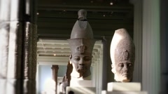 Long view of huge Egyptian pharoah statues Stock Footage