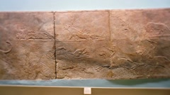 Assyrian lion hunt sculpted relief Stock Footage