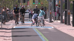 Toronto new bike lanes and bike paths and cyclists using them - stock footage