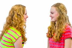 Two dutch sisterss looking at each other - stock photo