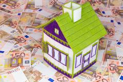 Embroidered house on euro notes Stock Photos