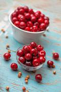 Sweet Cherry in Bowl on Rustic Table Stock Photos