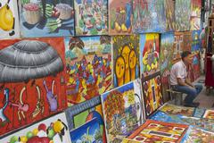 Man sells works of local artists, Santo Domingo, Dominican Republic. Stock Photos