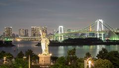 Statue of Liberty and Rainbow bridge in Odaiba, Nightview Stock Photos