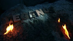 Legends Word at night in flames Stock Footage