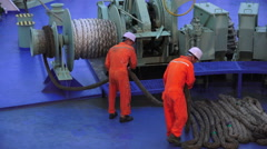 Sailors Work With Rope Reeling In Mooring On Ferry Ship At Seaport Shimonosek Stock Footage