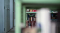 Bookshelves in university library Stock Footage