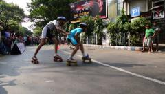 City children rollerskating on closed Street, having fun - editorial footage.. Stock Footage