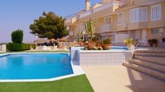 Typical mediterranean townhouses, pool, establishing shot, steadicam. - stock footage