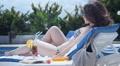 Young lady in bikini sunbathing on deck chair, enjoying vacation Footage