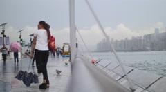 Asian family at Hong Kong prmenade 4K Stock Footage