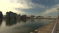 DUBLIN LIFFEY RIVER SAMUEL BECKETT BRIDGE PAN 1080p Stock Footage