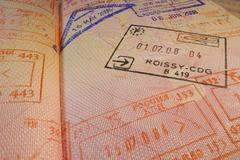 Passport page with Roissy-CDG  French immigration control stamp. Stock Photos