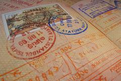 Passport page with Turkey visa and immigration control stamps. - stock photo