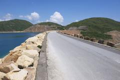 Road over the dam, Hong Kong, China. - stock photo