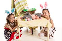 Three sisters  with Easter bunny ears Stock Photos