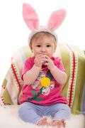 Expressive Easter baby girl - stock photo