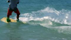 Kiteboarder jumps into the sea - stock footage