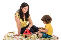 Mother and toddler son playing together - stock photo
