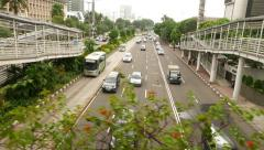 Light traffic on wide street, overhead view from moving camera Stock Footage