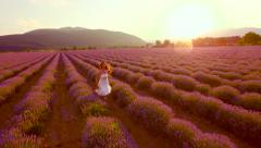 Aerial View Woman Running Through Lavender Filed At Sunset Free Joyful Happy Stock Footage