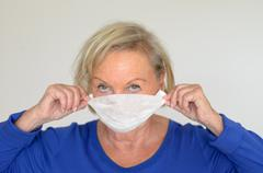 Woman with a surgical mask - stock photo