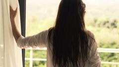 Young woman unveil curtain  HD Stock Footage