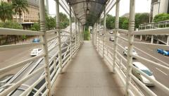 Move down by foot ramp, pedestrian overpass crossing MH. Thamrin street Stock Footage