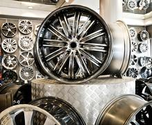 Various alloy wheels - stock photo