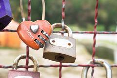 red heart-shaped padlock - stock photo
