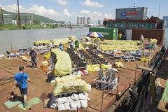People set equipment for the fireworks contest in Macau, China. - stock photo