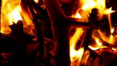 Opening fireplace and adding wood to the fire. - stock footage