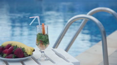 Fresh summer cocktail, fruit near swimming pool, all inclusive - stock footage