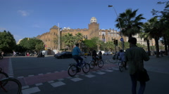 Riding bikes near La Monumental in Barcelona Stock Footage
