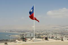 People enjoy the view to Arica city, Arica, Chile. - stock photo