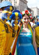 Sweden fans with ukrainian girl - stock photo