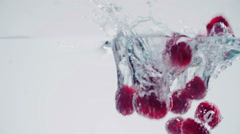 Raspberries Splashing into Water Stock Footage