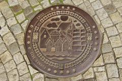 Exterior of the decorated sewer manhole in Bergen, Norway. Stock Photos