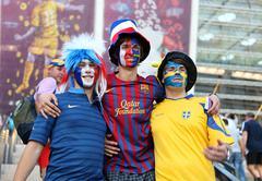Football fans on Olympic stadium - stock photo